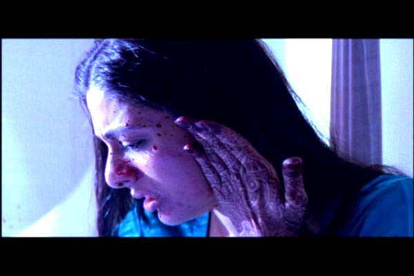 Nimmi splattered with blood during the assassination